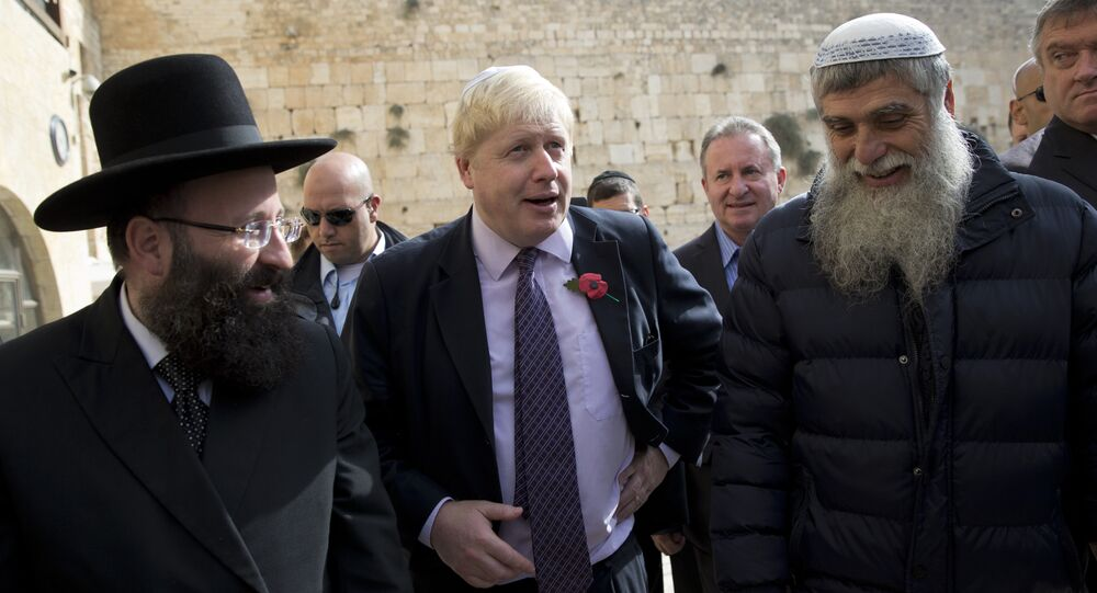 Mayor of London Boris Johnson visits at the Western Wall, the holiest site where Jews can pray in Jerusalem's Old City, Wednesday, Nov. 11, 2015.