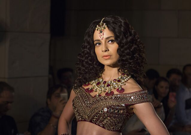 Kangana Ranaut displays a creation by Indian designer Manav Gangwani at the India Couture Week 2016, in New Delhi, India, 24 July 2016
