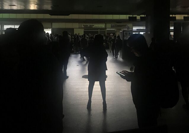 Passengers are seen during a blackout at Simon Bolivar international airport in Caracas, Venezuela March 25, 2019