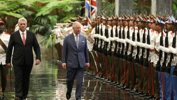 Cuba's President Miguel Diaz-Canel and Britain's Prince Charles review an honour guard during a ceremony at the Revolution Palace in Havana - Sputnik International