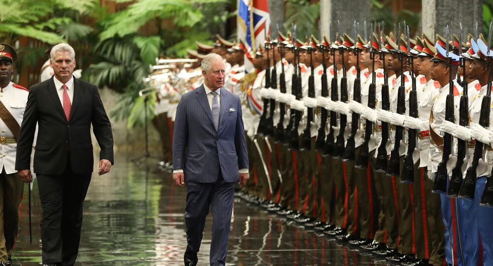 Cuba's President Miguel Diaz-Canel and Britain's Prince Charles review an honour guard during a ceremony at the Revolution Palace in Havana