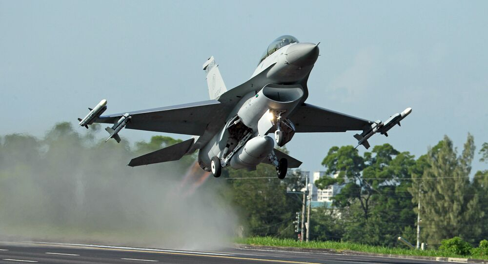 In this Sept. 16, 2014, file photo, a Taiwan Air Force F-16 fighter jet takes off from a closed section of highway during the annual Han Kuang military exercises in Chiayi, central Taiwan