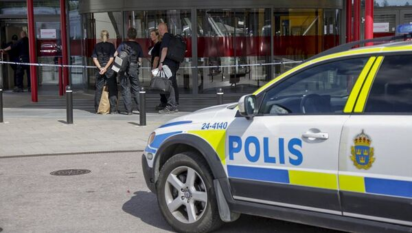 Police officers are seen in front of an Ikea store in Vasteras, central Sweden, August 10, 2015 - Sputnik International