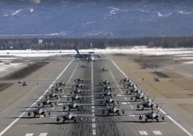 An elephant walk of 24 F-22 Raptor stealth fighters, a C-17 Globemaster III transport plane and an E-3 Sentry command and control surveillance craft take off from Alaska's Joint Base Elmendorf-Richardson base March 26, 2019.