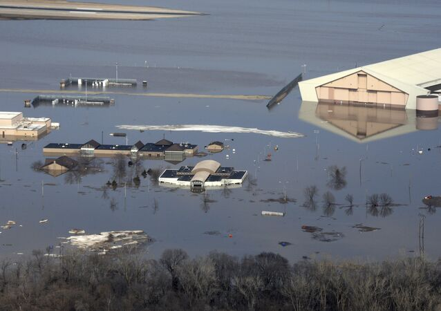 This March 17, 2019 photo released by the U.S. Air Force shows an aerial view of Offutt Air Force Base and the surrounding areas affected by flood waters in Neb. Surging unexpectedly strong and up to 7 feet high, the MissouriRiver floodwaters that poured on to much the Nebraska air base that houses the U.S. Strategic Command overwhelmed the frantic sandbagging by troops and their scramble to save sensitive equipment, munitions and aircraft.
