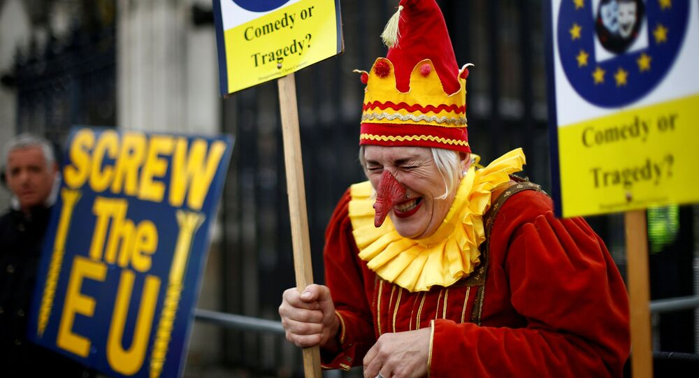 An anti-Brexit protester reacts next to a pro-Brexit protester in London, Britain, March 27, 2019.