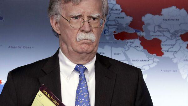 National security adviser John Bolton listens during a press briefing at the White House, Monday, Jan. 28, 2019, in Washington.  - Sputnik International