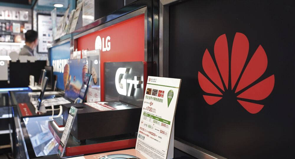 A logo of Huawei is displayed at a electronic retail shop in Hong Kong, Friday, March 29, 2019. Chinese tech giant Huawei's deputy chairman defended its commitment to security Friday after a stinging British government report added to Western pressure on the company by accusing it of failing to repair dangerous flaws in its telecom technology.