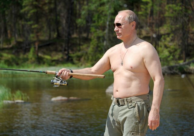 File photo: Russian President Vladimir Putin fishes in the Tuva Republic. 20 July 2013
