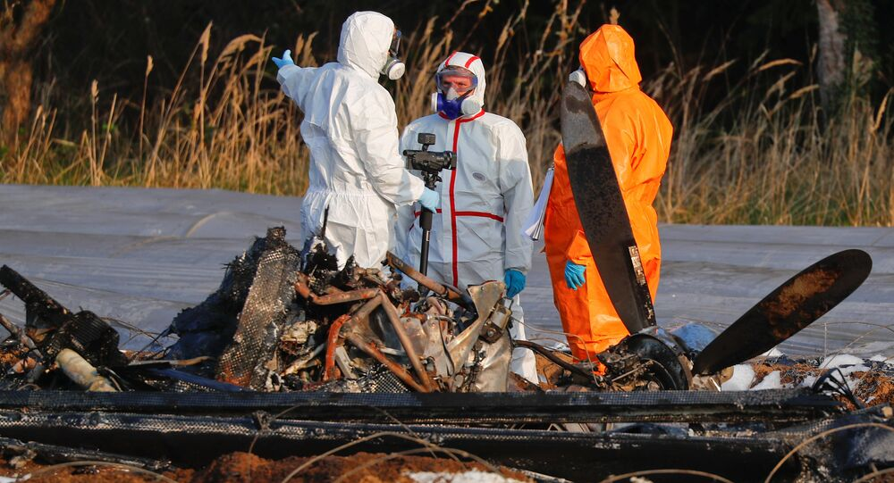 Forensic experts work next to the remains of a small plane that crashed near Erzhausen, Germany April 1, 2019. Natalia Fileva, chairwoman and co-owner of Russia's second largest airline S7, died when a private jet she was in crashed near Frankfurt on Sunday, the company said