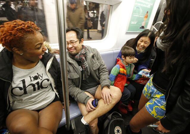 People laughing on the New York subway