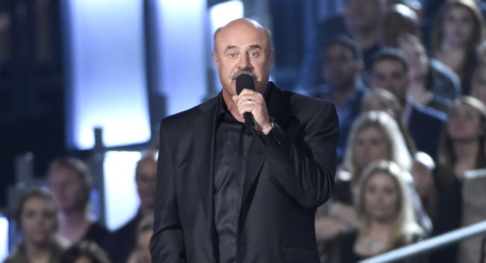 Dr. Phil McGraw speaks on stage at the 50th annual Academy of Country Music Awards at AT&T Stadium on Sunday, April 19, 2015, in Arlington, Texas.