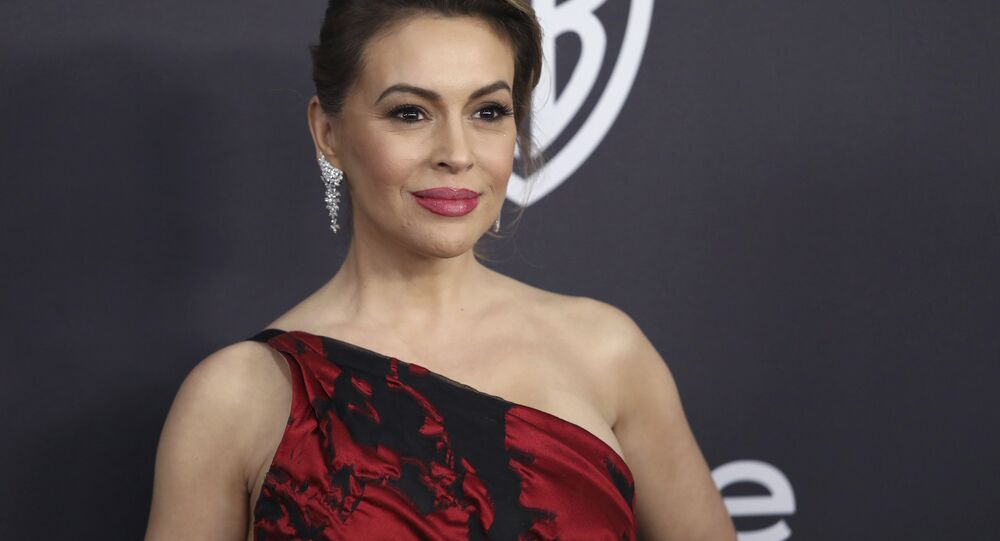 In this 6 January, 2019 file photo, Alyssa Milano arrives at the InStyle and Warner Bros. Golden Globes afterparty at the Beverly Hilton Hotel in Beverly Hills, California
