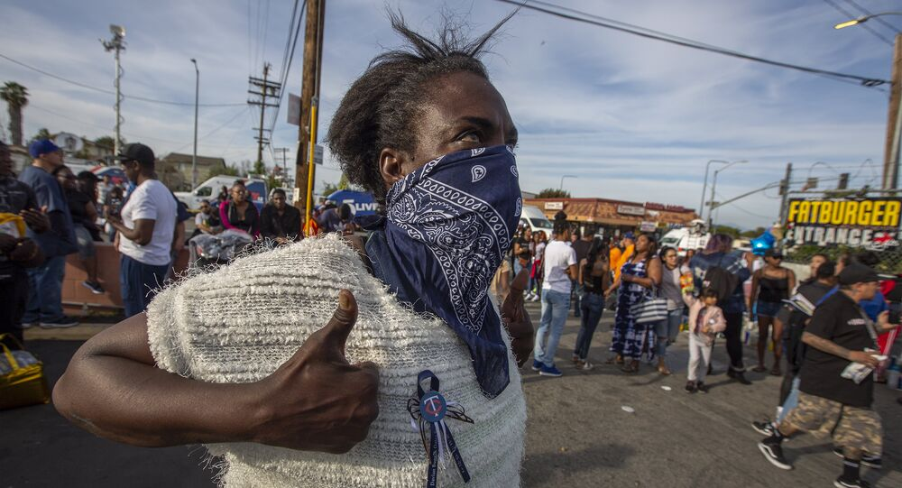 People gather to mourn for rapper Nipsey Hussle, 33, on April 1, 2019 in Los Angeles, California