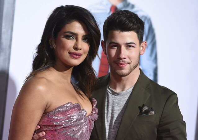 Cast member Priyanka Chopra and her husband Nick Jonas arrive at the Los Angeles premiere of Isn't It Romantic at The Theatre at Ace Hotel on Monday, Feb. 11, 2019