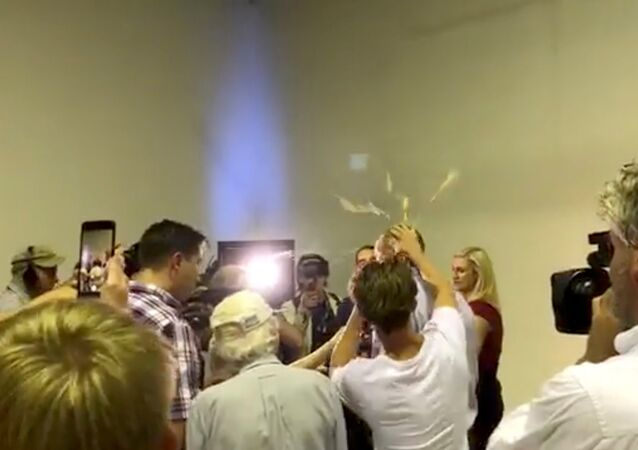 Australian Senator Fraser Anning has an egg smashed on his head while talking to the media in Victoria, Australia March 16, 2019 in this still image taken from a video obtained from social media