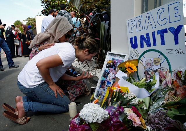 A woman cries next to a tribute to victim Hussein Al-Umari outside Al-Noor mosque after it was reopened in Christchurch, New Zealand, March 23, 2019
