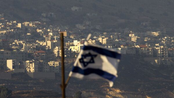 Oct. 11, 2018, an Israeli flag in front of the village of Majdal Shams in the Israeli-controlled Golan Heights. Syria slammed President Donald Trump's abrupt declaration that Washington will recognise Israel's sovereignty over the Israeli-occupied Golan Heights, saying Friday March 22, 2019, the statement was irresponsible and a threat to international peace and stability - Sputnik International