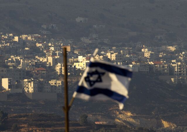 Oct. 11, 2018, an Israeli flag in front of the village of Majdal Shams in the Israeli-controlled Golan Heights. Syria slammed President Donald Trump's abrupt declaration that Washington will recognise Israel's sovereignty over the Israeli-occupied Golan Heights, saying Friday March 22, 2019, the statement was irresponsible and a threat to international peace and stability