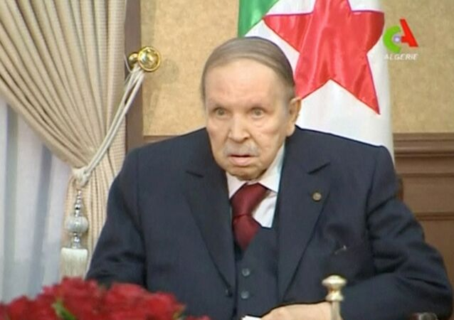 FILE PHOTO: Algeria's President Abdelaziz Bouteflika looks on during a meeting with army Chief of Staff Lieutenant General Gaid Salah in Algiers, Algeria, in this handout still image taken from a TV footage released on March 11, 2019.