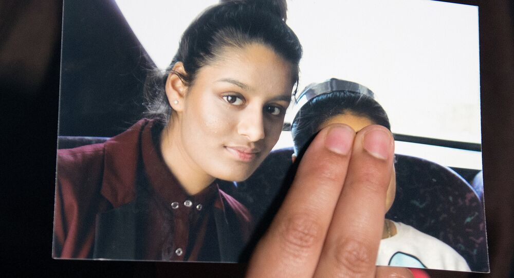 FILE PHOTO: Renu Begum, sister of teenage British girl Shamima Begum, holds a photo of her sister as she makes an appeal for her to return home at Scotland Yard, in London, Britain February 22, 2015.