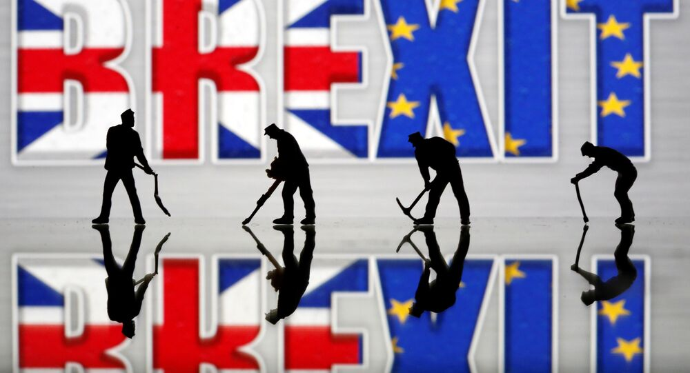 Small toy figures are seen in front of a Brexit logo in this illustration picture, March 30, 2019
