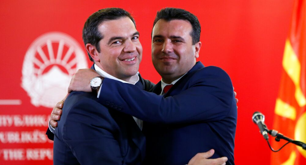 Greek Prime Minister Alexis Tsipras and North Macedonia's Prime Minister Zoran Zaev hug as they attend a news conference in Skopje, North Macedonia April 2, 2019.