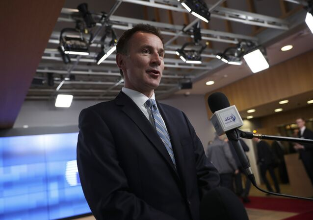 British Foreign Secretary Jeremy Hunt speaks with the media as he arrives to an EU Foreign Ministers meeting at the European Council headquarters in Brussels, Monday, Feb. 18, 2019