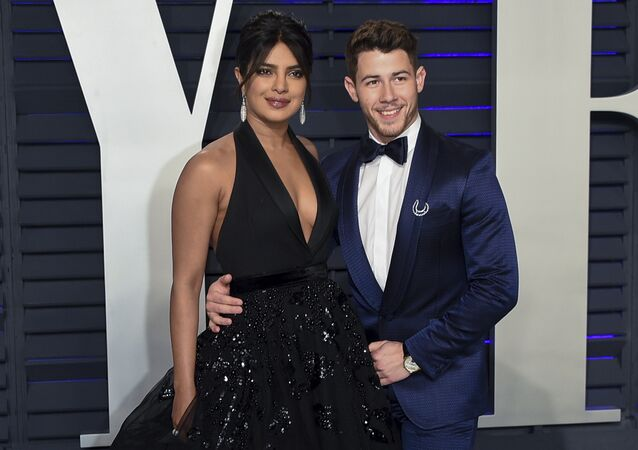 Priyanka Chopra, left, and husband Nick Jonas arrive at the Vanity Fair Oscar Party on Sunday, Feb. 24, 2019, in Beverly Hills, Calif