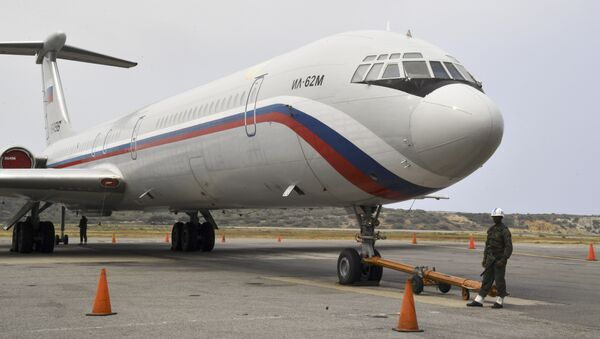 A Russian Ilyushin Il-62M Air Force plane, one of the two Russian military planes that arrived with troops and equipment to Venezuela last weekend, sits on the tamrac at Simon Bolivar International Airport on March 29, 2019 in Maiquetia, Vargas state, northern Venezuela - Sputnik International