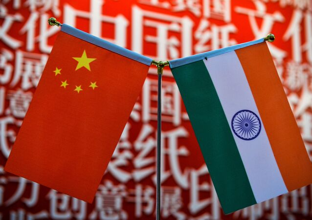 The national flags of India (R) and China are seen at the Delhi World Book fair at Pragati Maidan in New Delhi on January 9, 2016