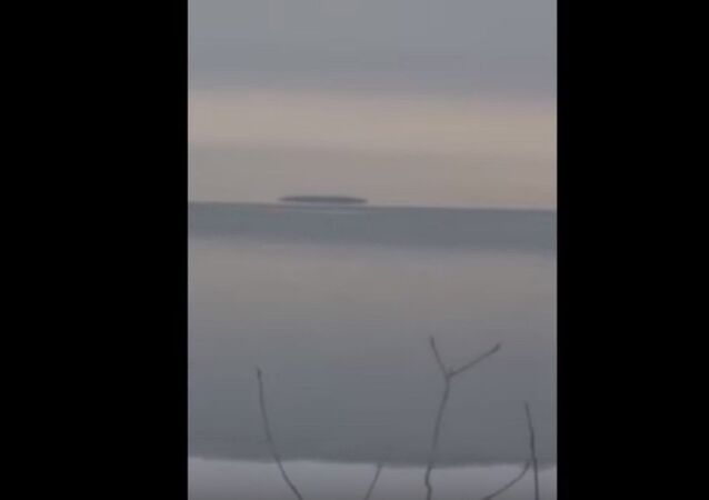 Mysterious object hovering on Lake Erie surface