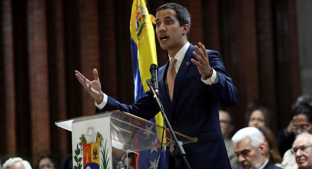 Venezuelan opposition leader Juan Guaido, who many nations have recognized as the country's rightful interim ruler, attends a meeting with political leaders at a university in Caracas, Venezuela April 1, 2019