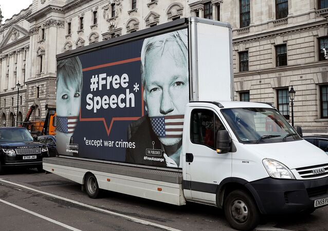 A truck carrying a poster relating to WikiLeaks founder Julian Assange, who has been living at Ecuador's embassy in London, drives through London, Britain April 3, 2019
