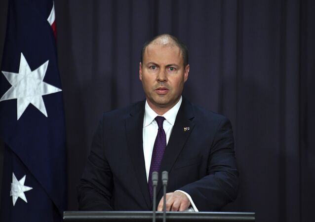 Australia's Treasurer Josh Frydenberg speaks at a press conference in response to the releasing of the Banking Royal Commission findings at Parliament House in Canberra, Monday, Feb. 4, 2019