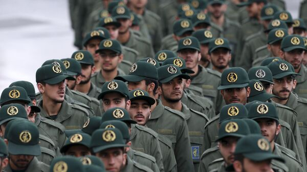 Iranian Revolutionary Guard members arrive for a ceremony celebrating the 40th anniversary of the Islamic Revolution, at the Azadi, or Freedom, Square, in Tehran, Iran, Monday, Feb. 11, 2019. - Sputnik International