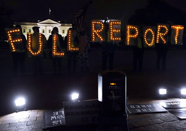 Protesters outside the White House in Washington DC, Monday, March 25, 2019, hold signs saying FULL REPORT, demanding that the complete results of special counsel Robert Mueller's investigation be released