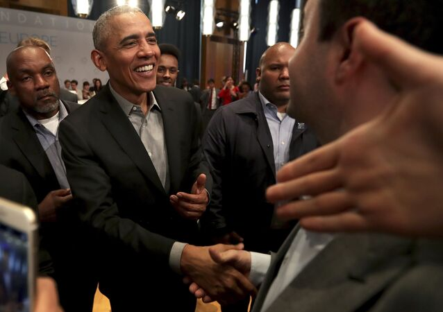Former US President Barack Obama shakes hands with visitors as he leaves after a town hall meeting at the 'European School For Management And Technology' (ESMT) in Berlin, Germany, Saturday, April 6, 2019.