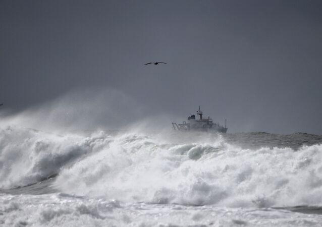 a ship navigates a rough ocean