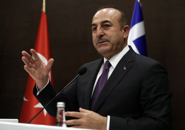 Turkey's Foreign Minister Mevlut Cavusoglu speaks to the media