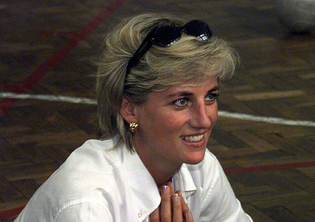 Diana, Princess of Wales, sits and chats to members of a Zenica volleyball team who have suffered injuries from mines, during her visit Saturday, August 9, 1997. The team members play by sitting on the floor and moving about the court on their arms. Diana is on the second day of a visit to Bosnia Herzegovina, aimed at publicizing her campaign to ban land mines.