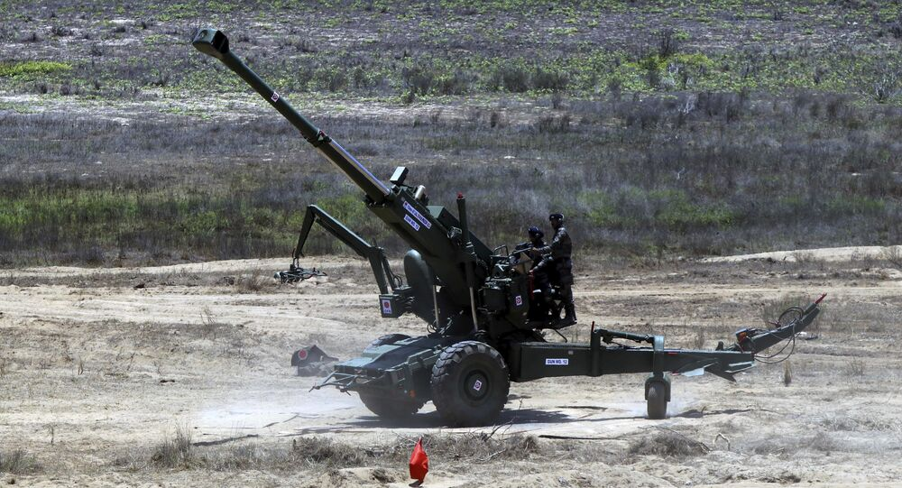 Indian army's Dhanush 155mm/45-caliber artillery gun is seen during a live demonstration at the defense expo in Kanchipuram, near Chennai, India, Wednesday, April 11, 2018