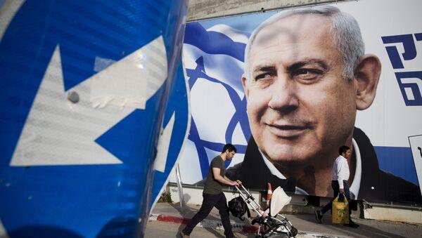 A man walks by an election campaign billboard showing Israel's Prime Minister Benjamin Netanyahu, the Likud party leader, in Tel Aviv, Israel, Sunday, April 7, 2019 - Sputnik International