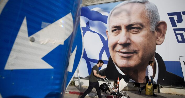 A man walks by an election campaign billboard showing Israel's Prime Minister Benjamin Netanyahu, the Likud party leader, in Tel Aviv, Israel, Sunday, April 7, 2019