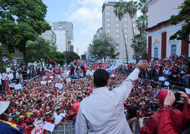 Venezuela's President Nicolas Maduro waves to supporters during a rally in support of the government in Caracas, Venezuela April 6, 2019.