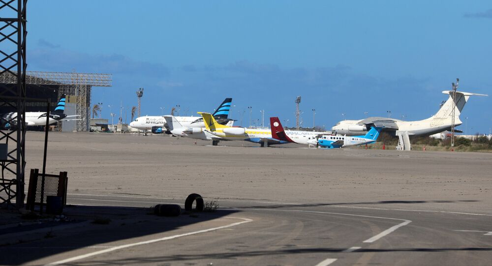 Airplanes are seen at Mitiga airport