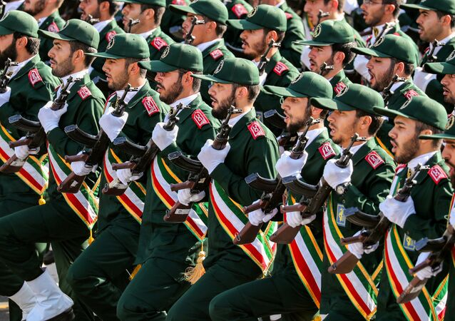 September 22, 2018 members of Iran's Revolutionary Guards Corps (IRGC) march during the annual military parade marking the anniversary of the outbreak of the devastating 1980-1988 war with Saddam Hussein's Iraq, in the capital Tehran