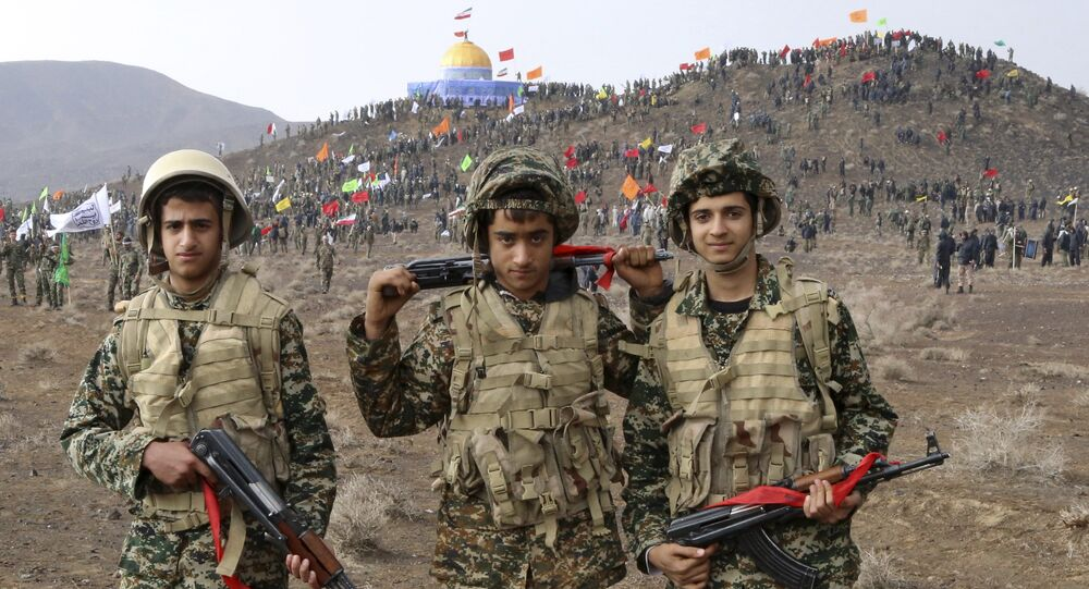 Nov. 20, 2015 photo released by the Fars News Agency, members of the Basij, the paramilitary unit of Iran's Revolutionary Guard, pose for a picture during a military exercise outside the holy city of Qom, central Iran