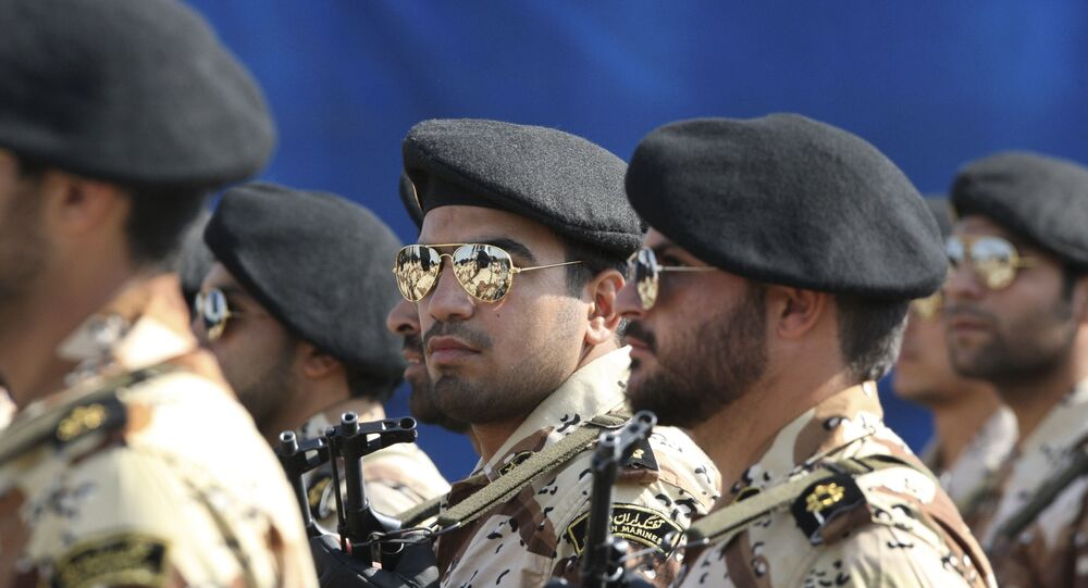 In this 22 September 2011 photo, members of Iran's Revolutionary Guard march in front of the mausoleum of the late Iranian revolutionary founder Ayatollah Khomeini, just outside Tehran, Iran, during armed an forces parade marking the 31st anniversary of the start of the Iraq-Iran war. Among the many mysteries inside Iran's ruling hierarchy, the Quds Force, which sits atop the vast military and industrial network of the Revolutionary Guard, has a special place in the shadows.