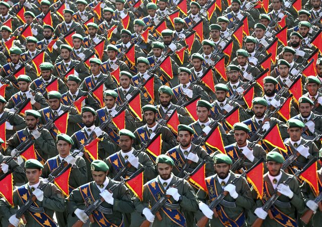 In this Sept. 21, 2016 file photo, Iran's Revolutionary Guard troops march in a military parade marking the 36th anniversary of Iraq's 1980 invasion of Iran, in front of the shrine of late revolutionary founder Ayatollah Khomeini, just outside Tehran, Iran.